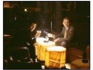 Empire movie still: Jack (Peter Sarsgaard) offers Victor (John Leguizamo) a shot at a major Wall Street score in Empire
