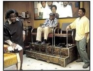 Barbershop movie still: Cedric The Entertainer as Eddie, Carl Wright as Checkers Fred and Ice Cube as Calvin in Barbershop