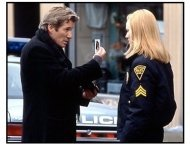 The Mothman Prophecies movie still: John Klein (Ricahrd Gere) and Sgt. Connie Parker (Laura Linney) explore the reports of an unexplained phenomena in the town of Point Pleasant
