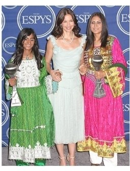 Ashley Judd, presenter (center), with Roia Noor Ahman and Shamila Kohestani of Afghanistan, winners of the Arthur Ashe Award for Courage
