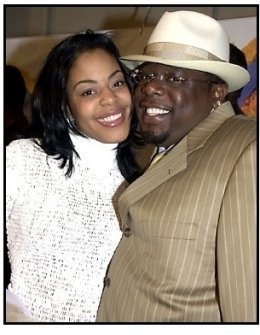 Cedric the Entertainer and date at the Kingdom Come premiere