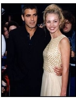 George Clooney and date at the Batman & Robin premiere