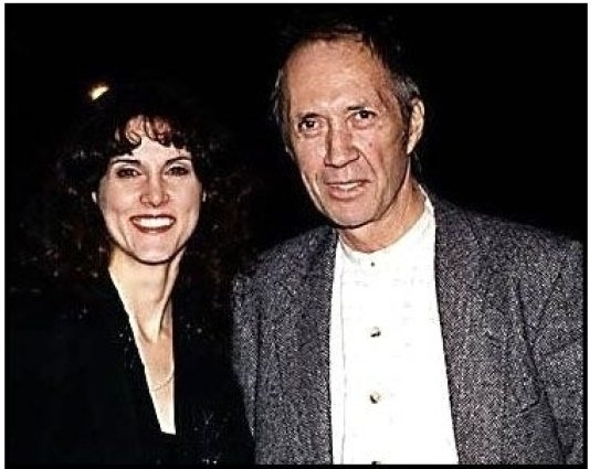 In Love and War premiere: David Carradine and date at the In Love and War premiere